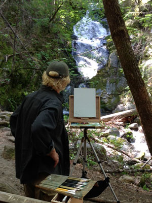 Artist Dave Seibert at the base of Boulder Creek Falls
