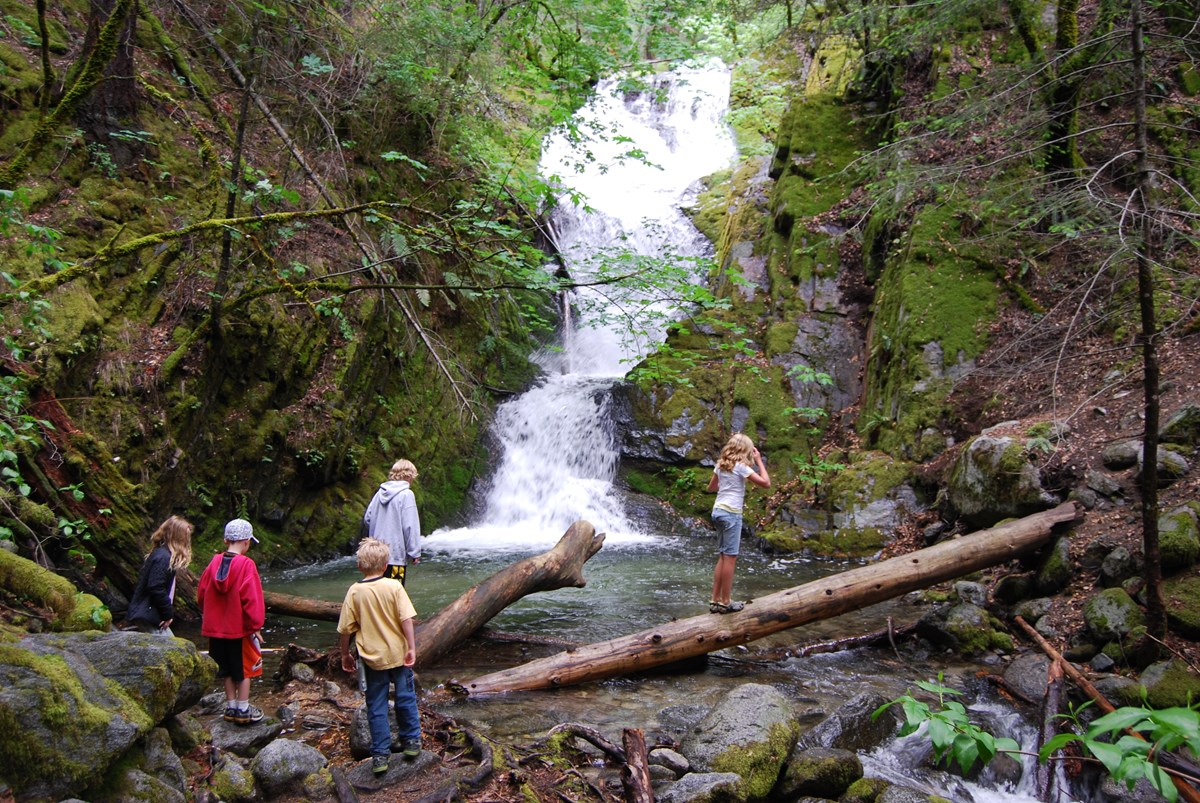 Visitors enjoying the sights and sounds of Boulder Creek Falls