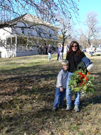 Cindy Milestone and her son, Sheridan, with their holiday wreath