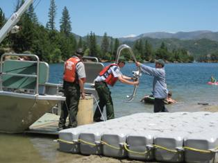 YCC crew-member assisting park staff with lake operations
