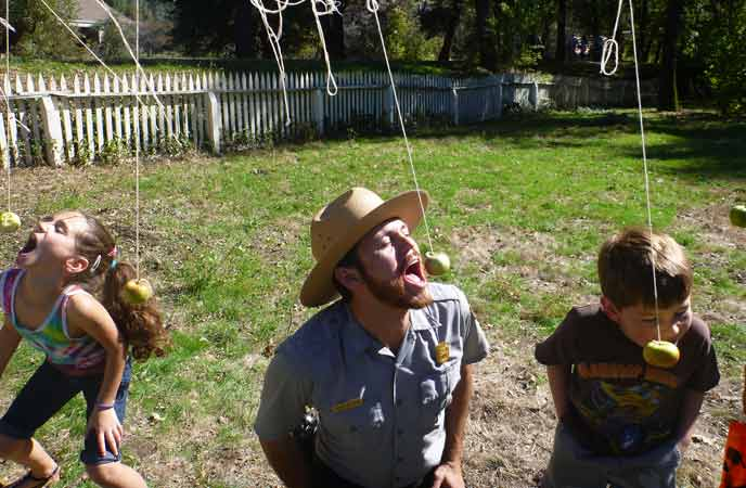 visitors playing apple game with park ranger