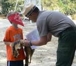 A young child explores nature during the Junior Ranger Program