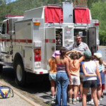 Junior Firefighters learning about Whiskeytown's fire engine.