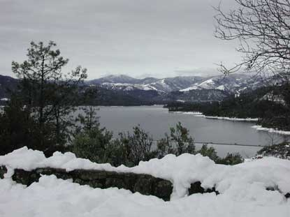 View of lake from Visitor Center with snow.