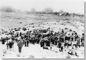 historic photo looking down a hill at a large group of people