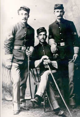 Studio photo of three US soldiers in 1884.