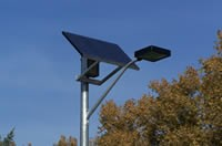 Close-up of solar panel on parking lot light poles.