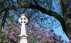 purple flowers and blue sky provide a striking backdrop for the top of the Gray's monument