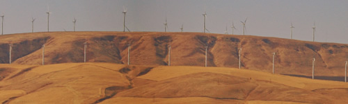 Modern windmills on distant hills