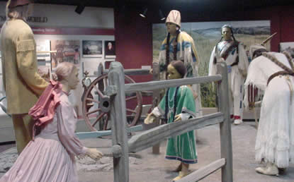 Center display in museum depicts Marcus and Narcissa meeting 4 Cayuse - a hunter, a young woman, an older woman, and a young girl.