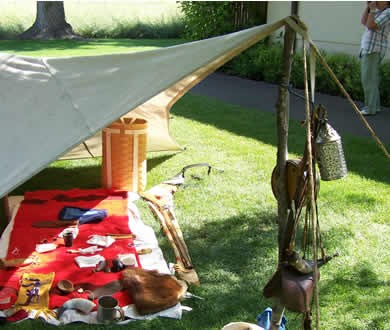 Tent filled with 1800s style items.