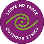 Purple circle with white letters, Leave No Trace logo