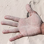 Hand covered with sand