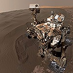 Mars rover Curiosity on Martian sand dunes.