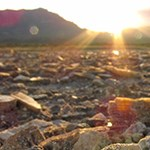 Selenite Crystals with mountains and a sunset on the background.