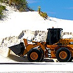 Heavy equipment loader machine operating in the dunes.