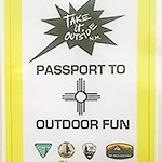 "A sign reads ""Passport to Outdoor Fun"""