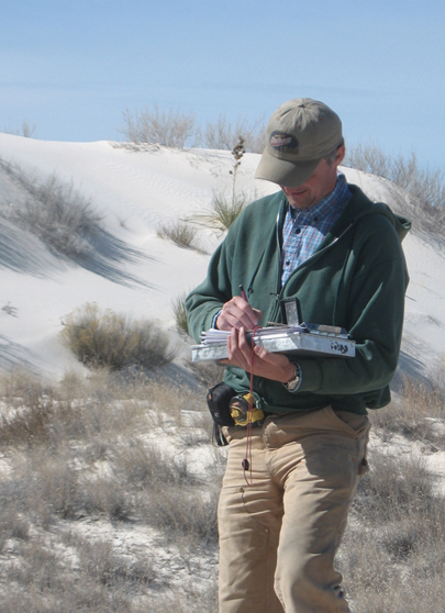 Researcher in the dunes.