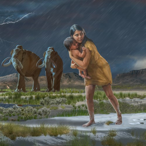 In a scene from the ice age, a woman holding a child on the shores of the ancient Lake Otero leave the footprints in the mud.
