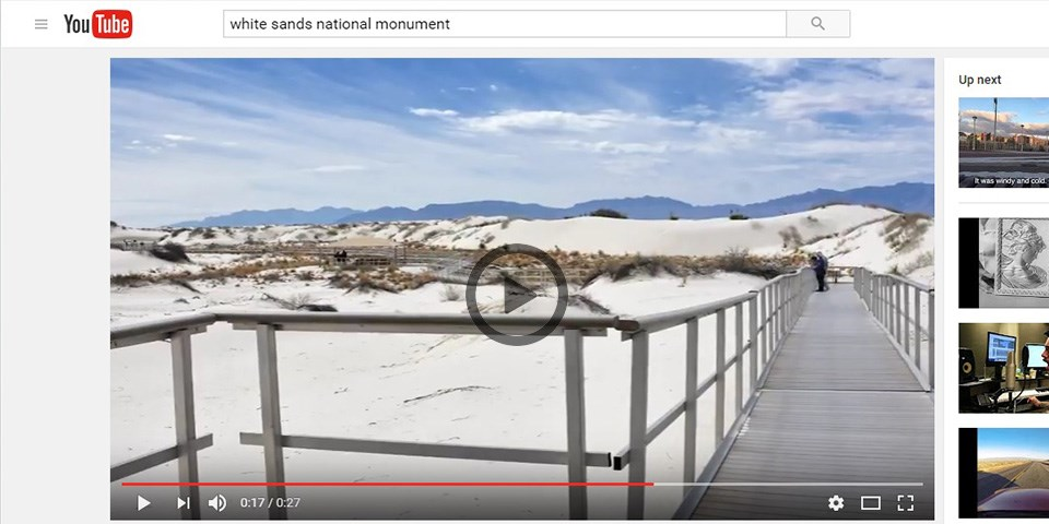 A video on YouTube showing a metal walk way in sand dunes