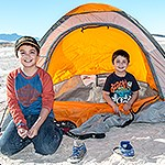 Two visitor kids backcountry camping in the dunefield.