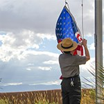 Park Ranger taking down American flag.
