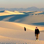Visitors Hiking on the white sand.