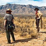 Actor Billy the Kid facing off with a Park Ranger