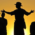 Silhouettes of a Park Ranger and visitors.
