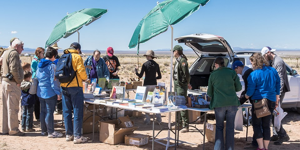 Rangers selling books at Trinity Site.
