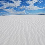 White dune with blue sky above