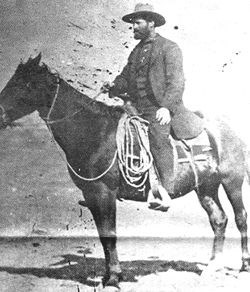 Historic black and white photograph of Tom Bingham on a horse