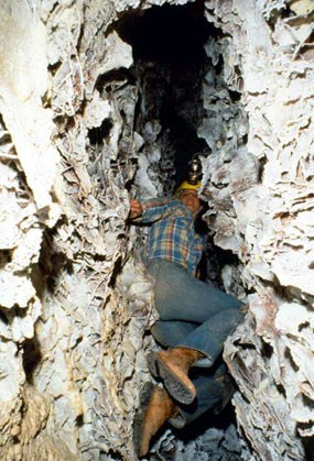 Caver descending the Boxwork Chimney