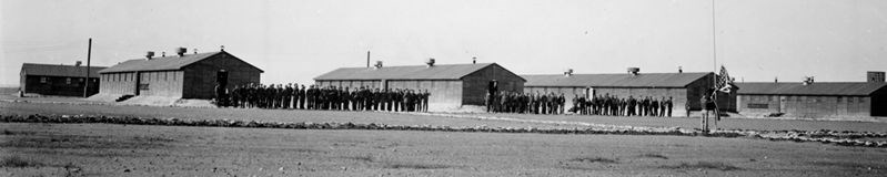 Black and white historic photograph of CCC Barracks
