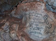 historic signatures written the walls of Wind Cave, dated Aug. 1882