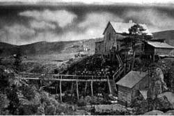 Historic black and white photograph of the Wind Cave Hotel, circa 1890s