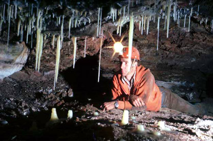 John Scheltens looks at stalactites in John Boys Christmas Loft