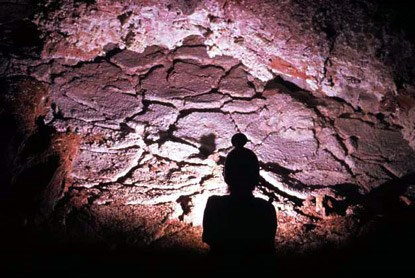 Caver at survey point KX1 mud flats and calcite cracks east of Half Mile Hall