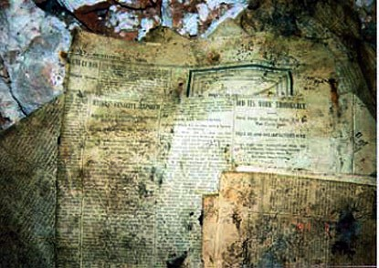Old newspapers found in the Lonely Palace.  Such papers were used to wrap frostwork and other cave features so that they could be carried out of the cave for sale before Wind Cave became a national park.
