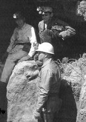 Black and white photograph of John Stretch and Other Members of the Colorado Grotto wearing caving gear inside Wind Cave