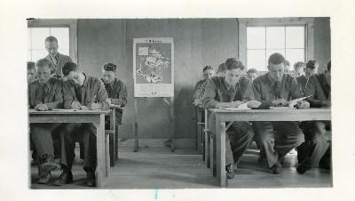 Photograph of CCC men in a classroom studying