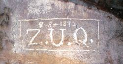 "Alvin McDonald's signature, ""ZUQ,"" etched on a cave wall.  Dated 9-8-1892"