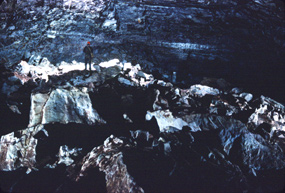 Cavers crossing the Figure 8 Room