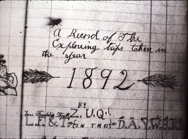 "black and white photo of an old journal entry reading ""A Record of the Exploreing (sic) taken in the year 1892, by Z.U.Q."""