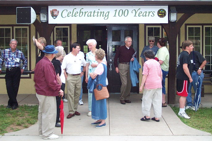 Crowd of people standing in front of the park visitor center in 2003 during the last employee reunion held by the park.