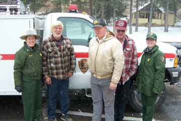 Superintendent Linda Stoll (far left) and Supervisory Forestry Technician Sabrina Henry (far right) with members of local volunteer fire departments.