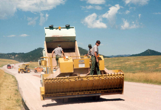 Wind Cave National Park maintenance staff preparing to chip and seal U. S. Highway 385.