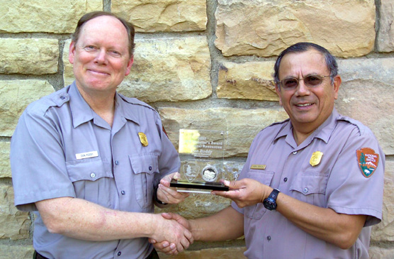 Dan Roddy receiving his Regional Natural Resource Management Award from park superintendent Vidal Davila.
