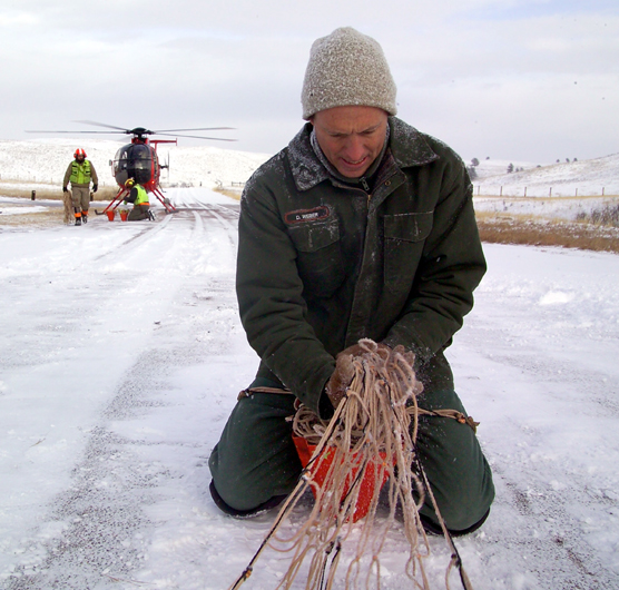 Biological Science Technician Duane Weber repackages a net used in Wind Cave National Park's elk capture operation.