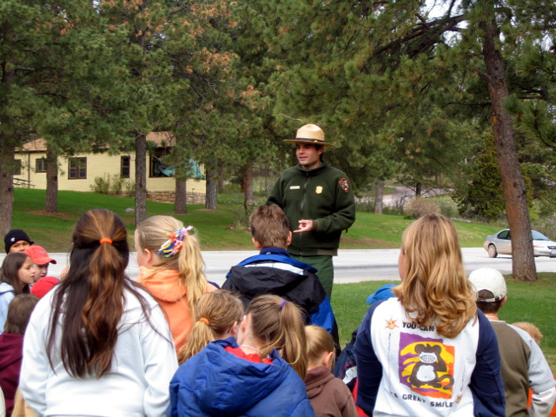 A park ranger conducting an environmental education program at Wind Cave National Park for area school children.
